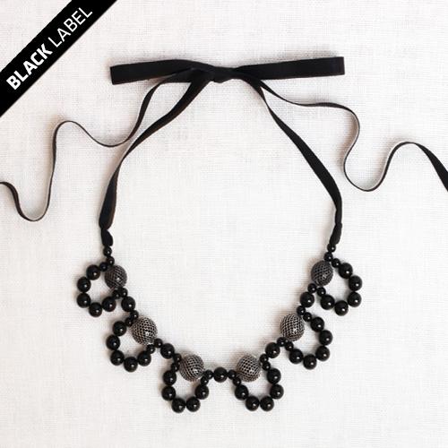 The Little Black Necklace